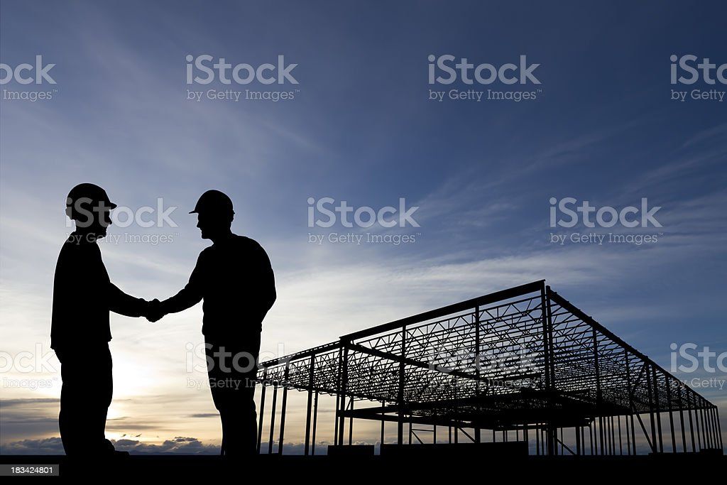 Construction Site Handshake royalty-free stock photo