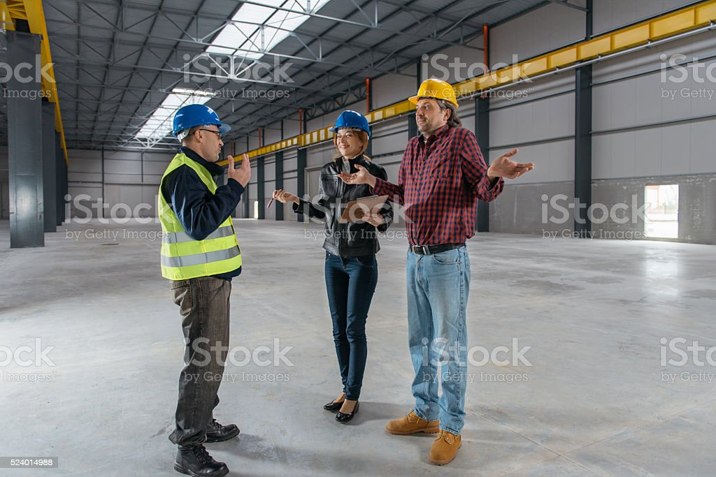 Construction Site Inspector having fun at work stock photo