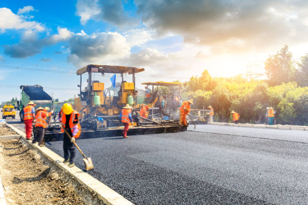 Construction site is laying new asphalt road pavement stock photo