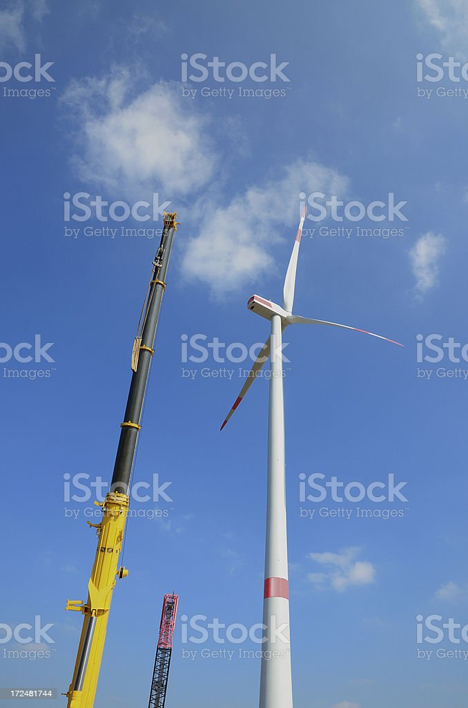 Construction site of wind turbine with cranes royalty-free stock photo