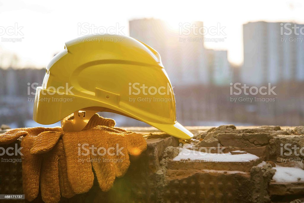 Construction site orange objects on snowy windowsill stock photo