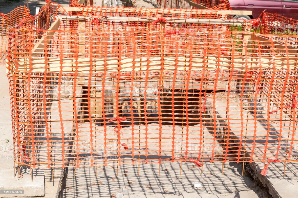 Construction Site Orange Safety Net Fence As Barrier Over The Trench On The Street Excavation Stock Photo Download Image Now Istock