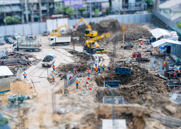 Construction site outdoor with crane People working top view stock photo