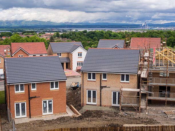 UK Construction site. A view of 2 newly built homes in a construction site in Central Scotland. housing development stock pictures, royalty-free photos & images