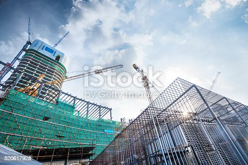 Construction site with crane and building in city