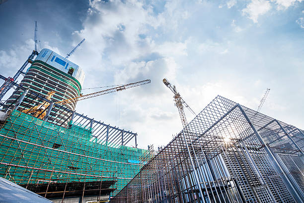 construction site - crane construction machinery stock pictures, royalty-free photos & images