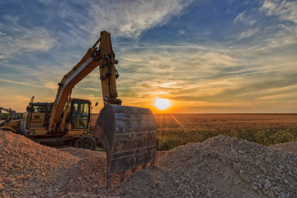 construction site excavator in construction site at stunning sunset archaeology stock pictures, royalty-free photos & images