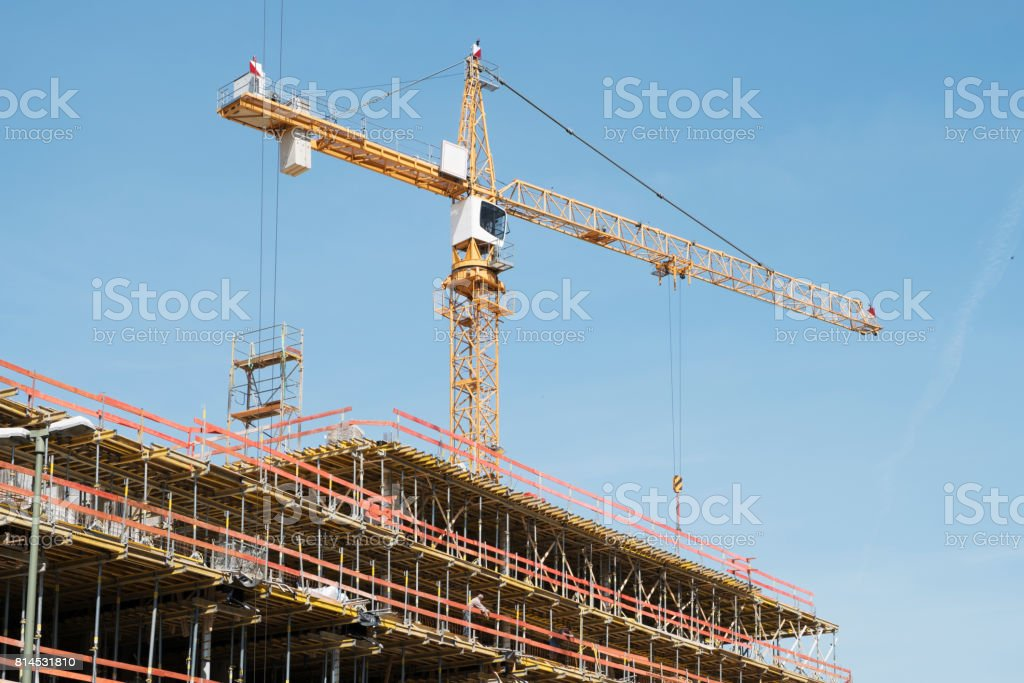 construction site -  scaffolding and crane on bulding site stock photo