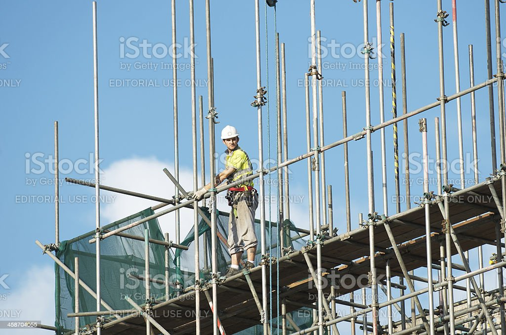 Construction Site Scaffolding and Worker London stock photo