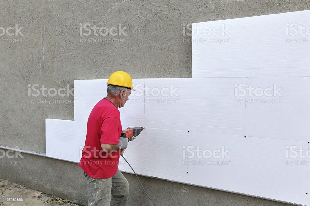 Construction site, styrofoam insulation drilling for anchor stock photo