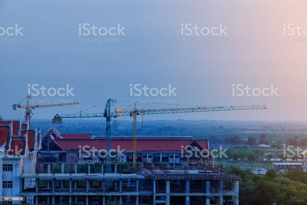 Construction site Unfinished cement building, Industrial construction cranes and building country local Thailand stock photo