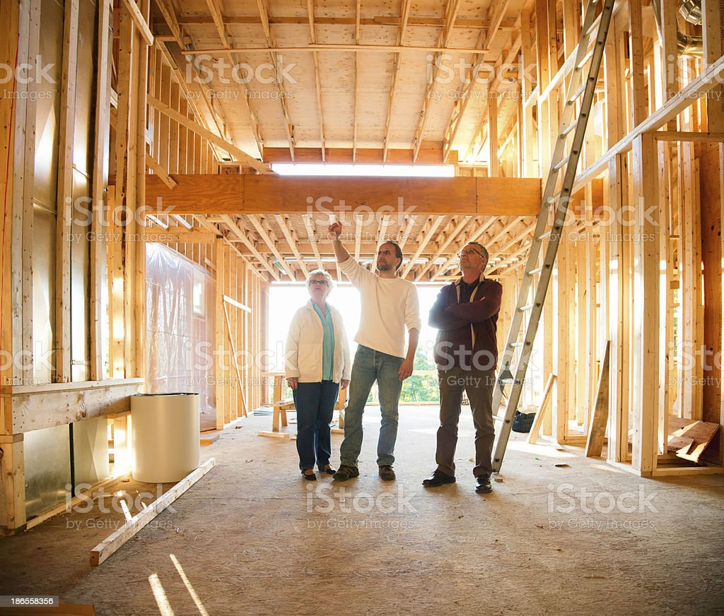 Construction site visit with architect royalty-free stock photo