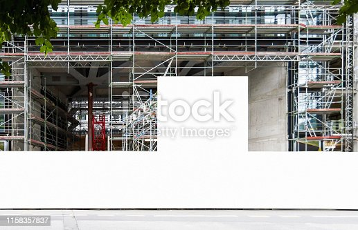 istock Construction site with blank construction fence mockup 1158357837