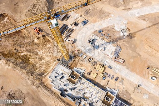construction site with crane and apartment building under construction. eye bird view