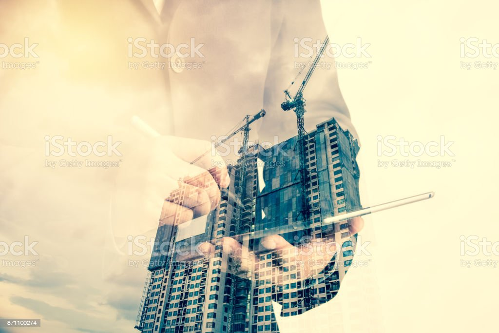 Construction site with crane and building stock photo