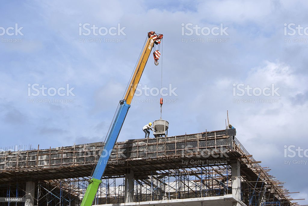 Construction site with crane and workers royalty-free stock photo