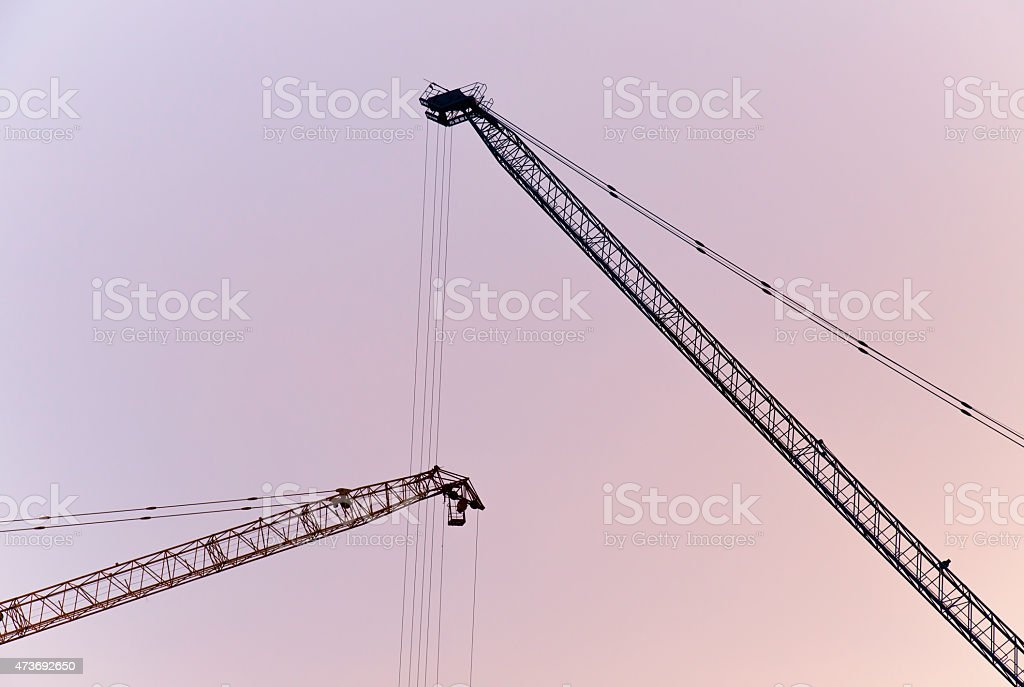 Construction site with crane - silhouette style stock photo