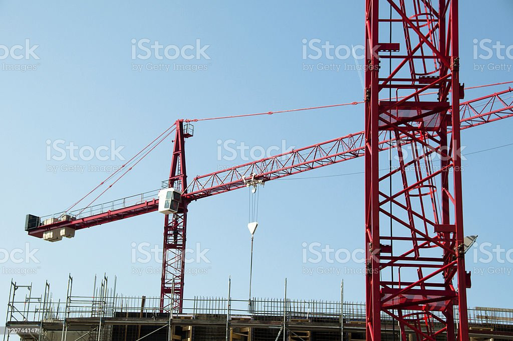 Construction site with cranes and building royalty-free stock photo