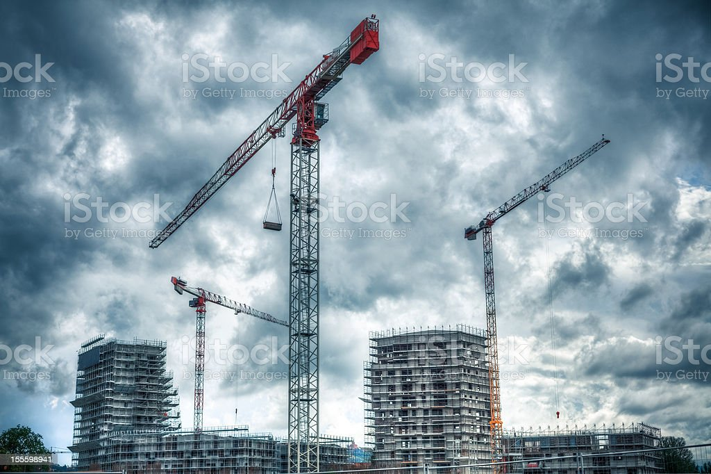 Construction Site with Cranes and Cloudy Sky royalty-free stock photo