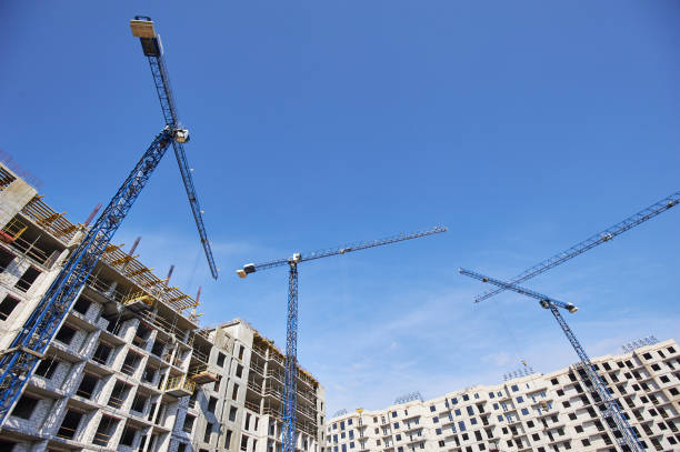 Construction site with cranes on sky background stock photo
