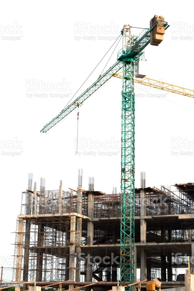 Concrete foundation of high rise building with full green tower crane...