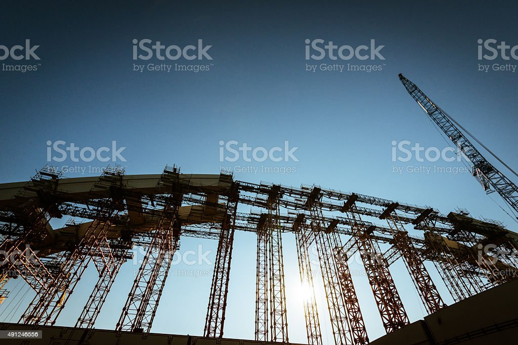 Construction site with large cranes and industrial machinery stock photo