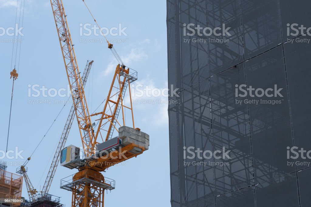 Construction site with the safety building net cover the building  against sky background royalty-free stock photo