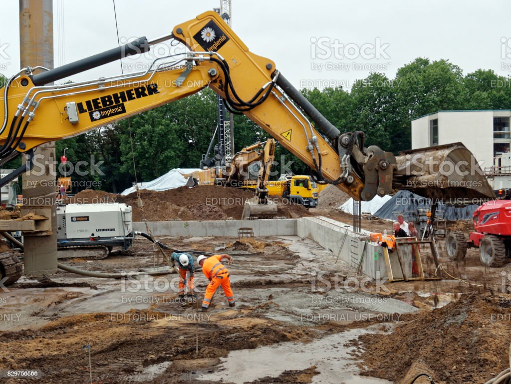 construction site with workers and machinery stock photo