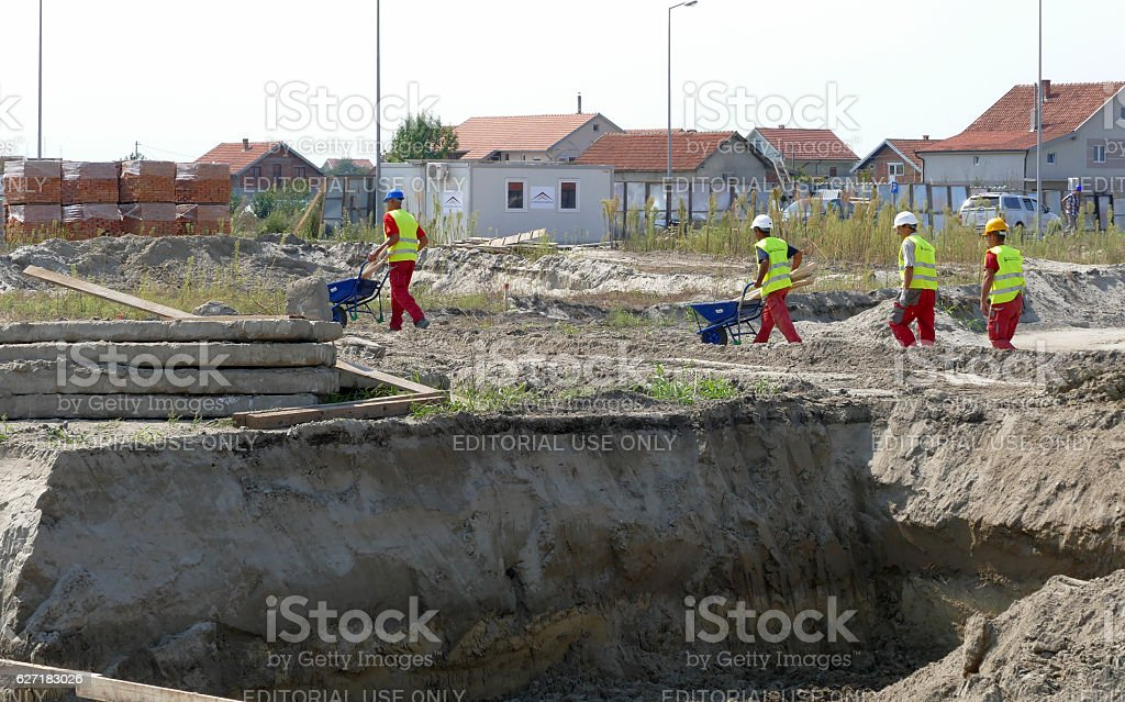 Construction site with workers preparing contruction of buildings with apartments stock photo