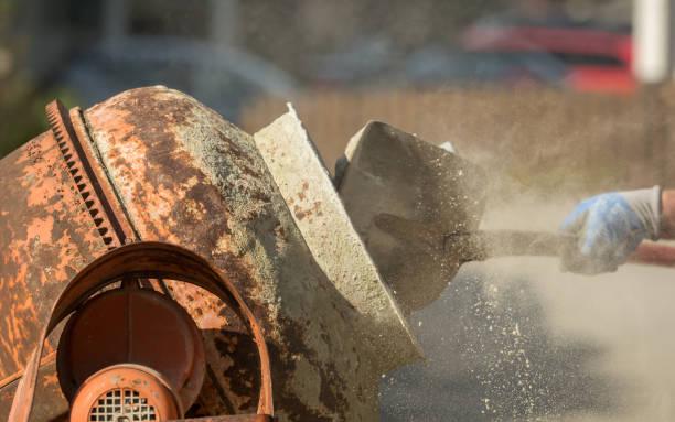Construction site work with concrete mixer and wheelbarrows stock photo