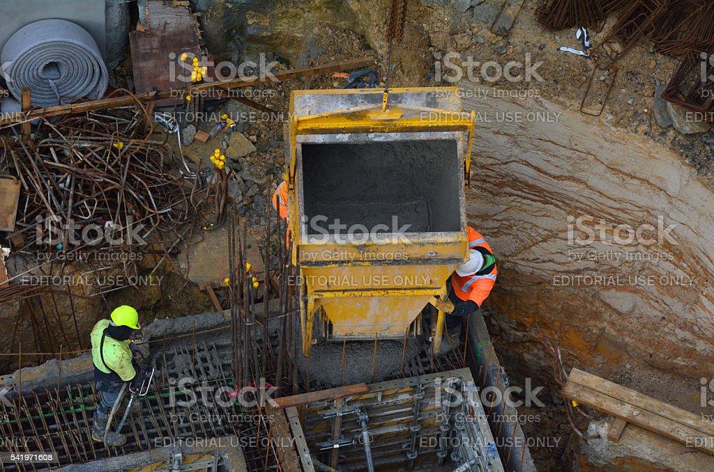 Construction site worker concrete pouring stock photo