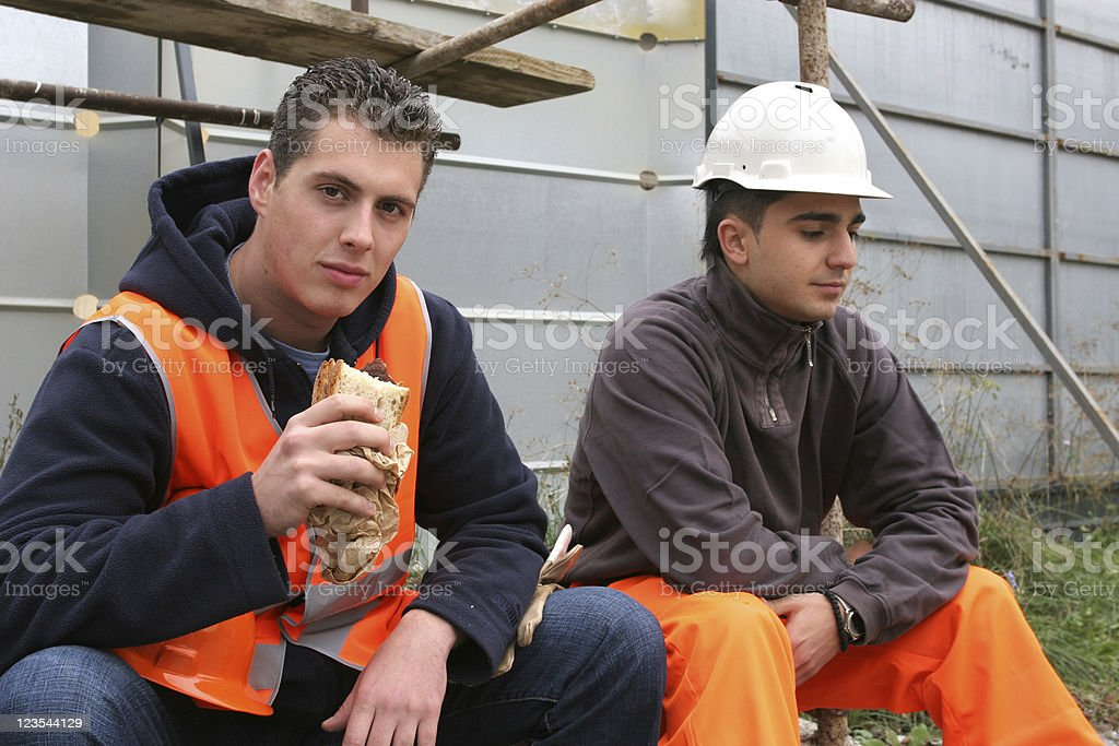 Construction site workers stock photo