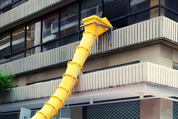 Construction Garbage Chute : Royalty free construction debris chute pictures images