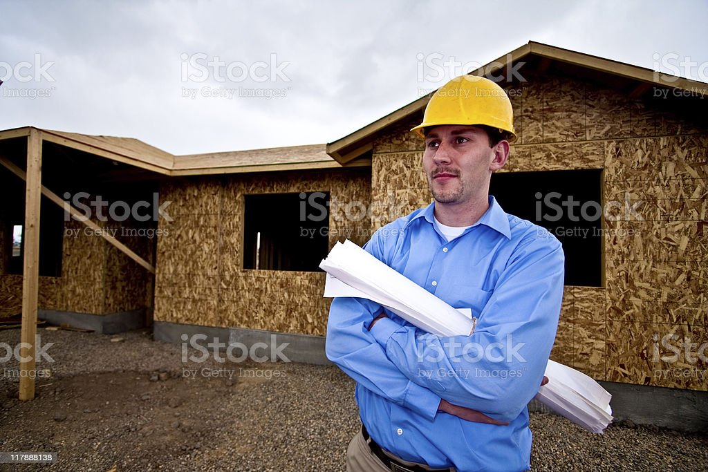 Construction Supervisor with Blue Prints royalty-free stock photo
