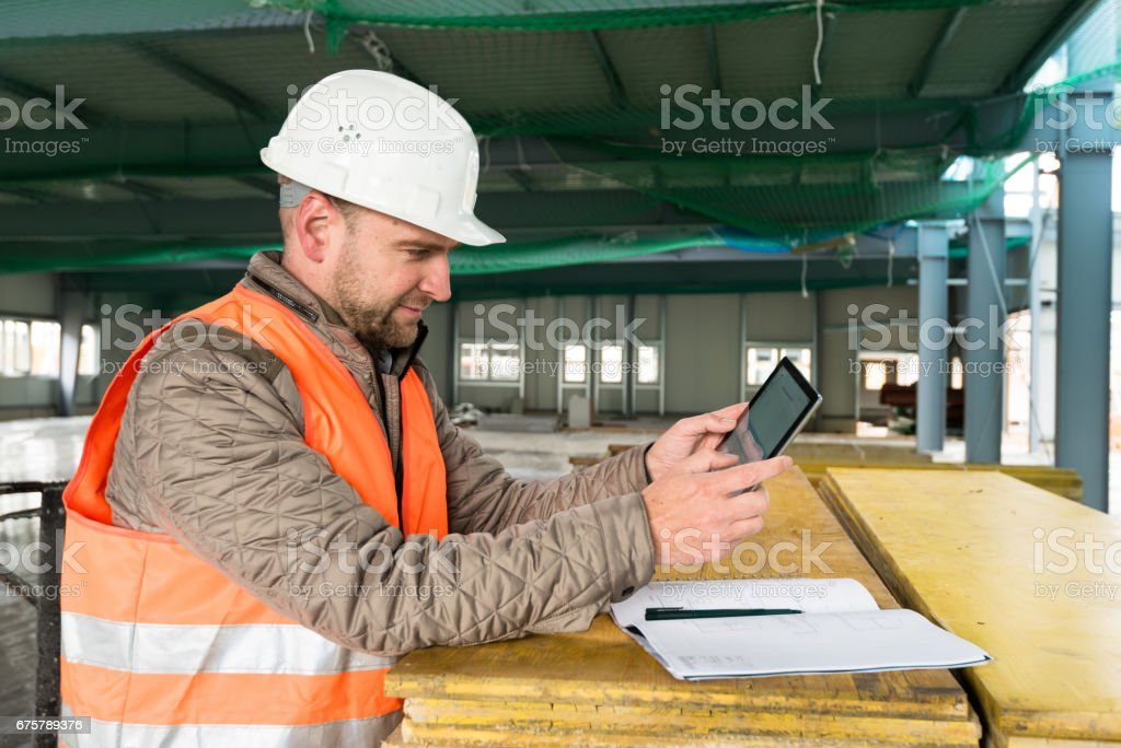 Construction supervisor with digital tablet on site royalty-free stock photo