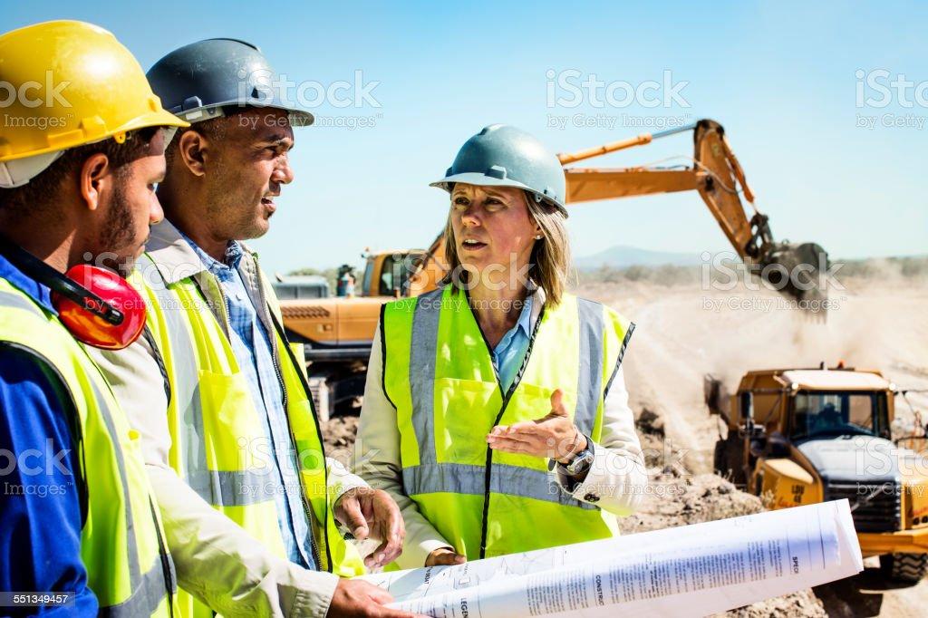 Construction team planning at quarry – Foto