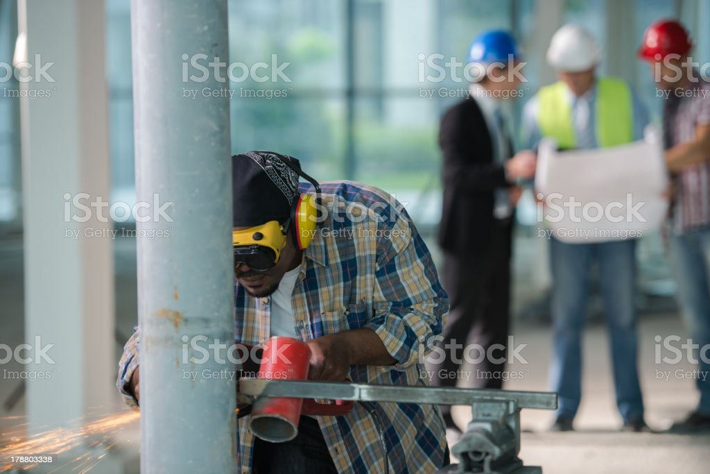 Construction team with welder in the front royalty-free stock photo