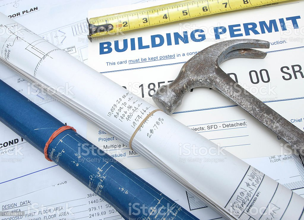 Construction themed image with plans, permits & tools royalty-free stock photo