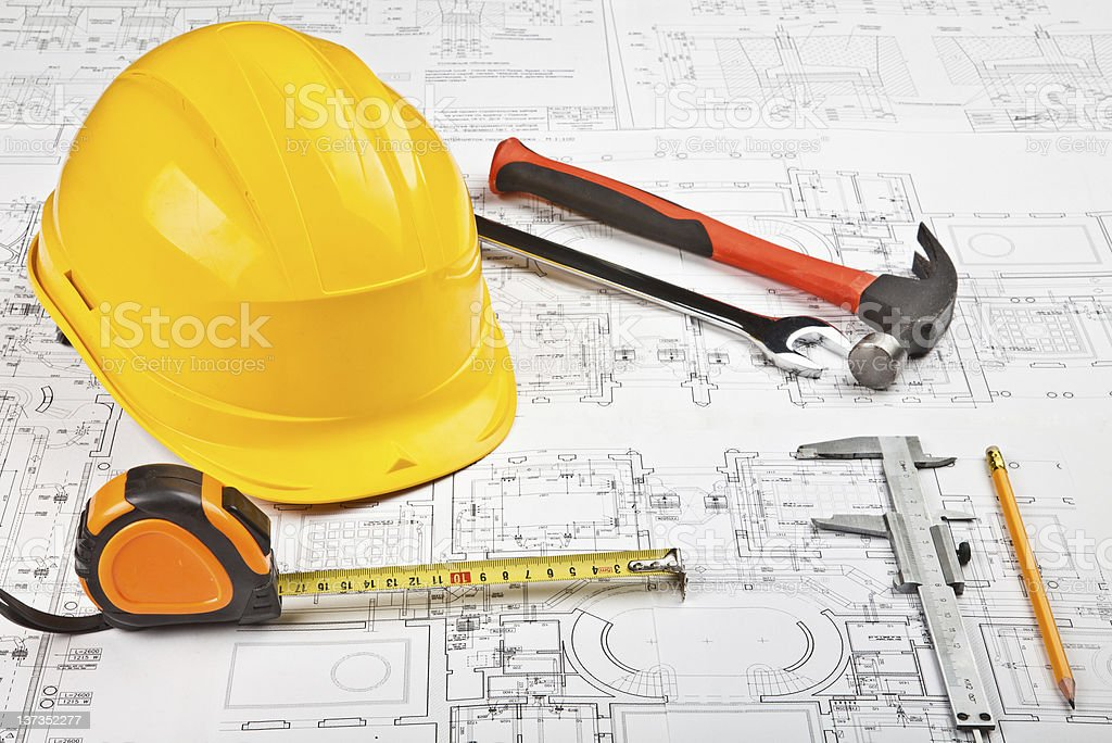 Construction tools on a buildings blueprint royalty-free stock photo