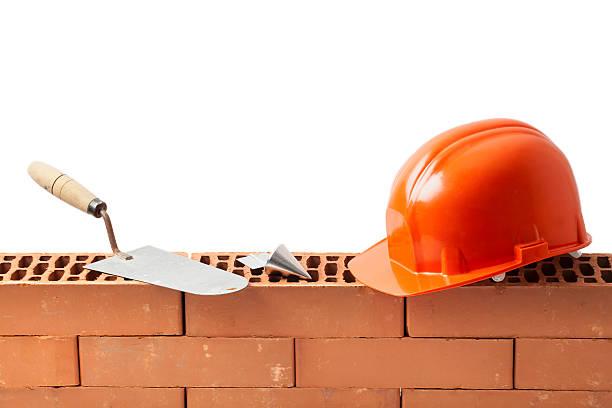 Construction Tools on a Wall of Bricks stock photo