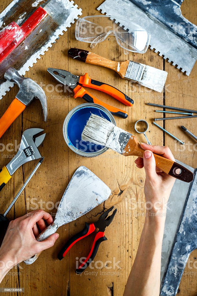 construction tools on a wooden table with blue paint foto royalty-free