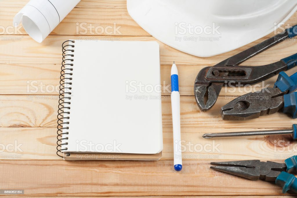 Construction tools white helmet notepad and pen on wooden background construction tools white helmet notepad and pen on wooden background py space for malvernweather Choice Image