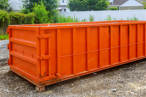 Construction trash garbage dumpsters on metal container house renovation.