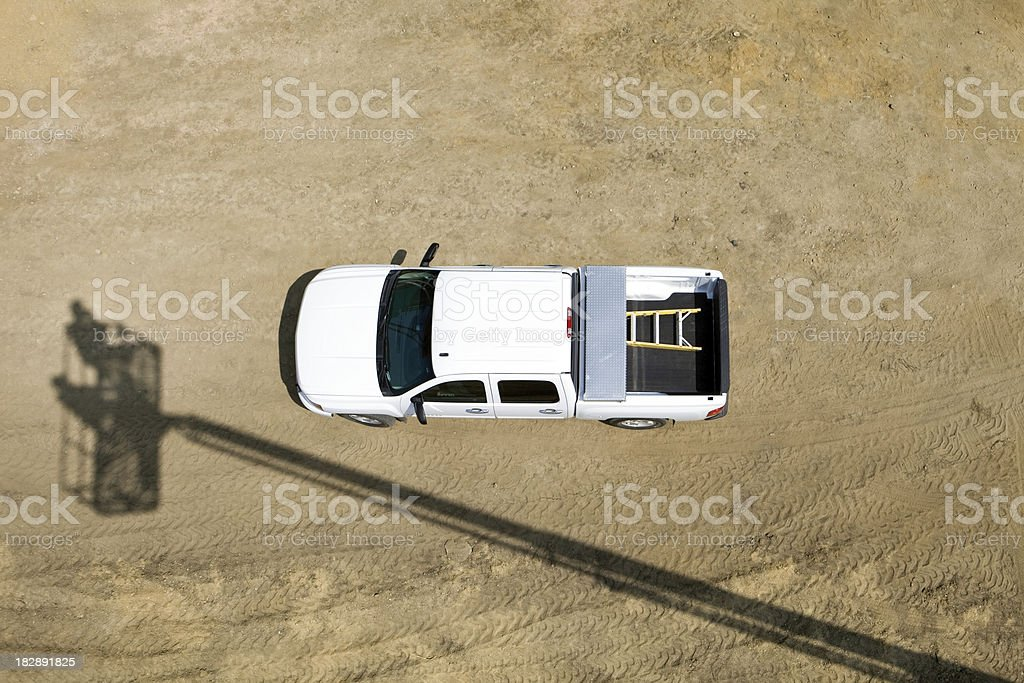 Construction Truck from above Isolated on Dirt Background royalty-free stock photo
