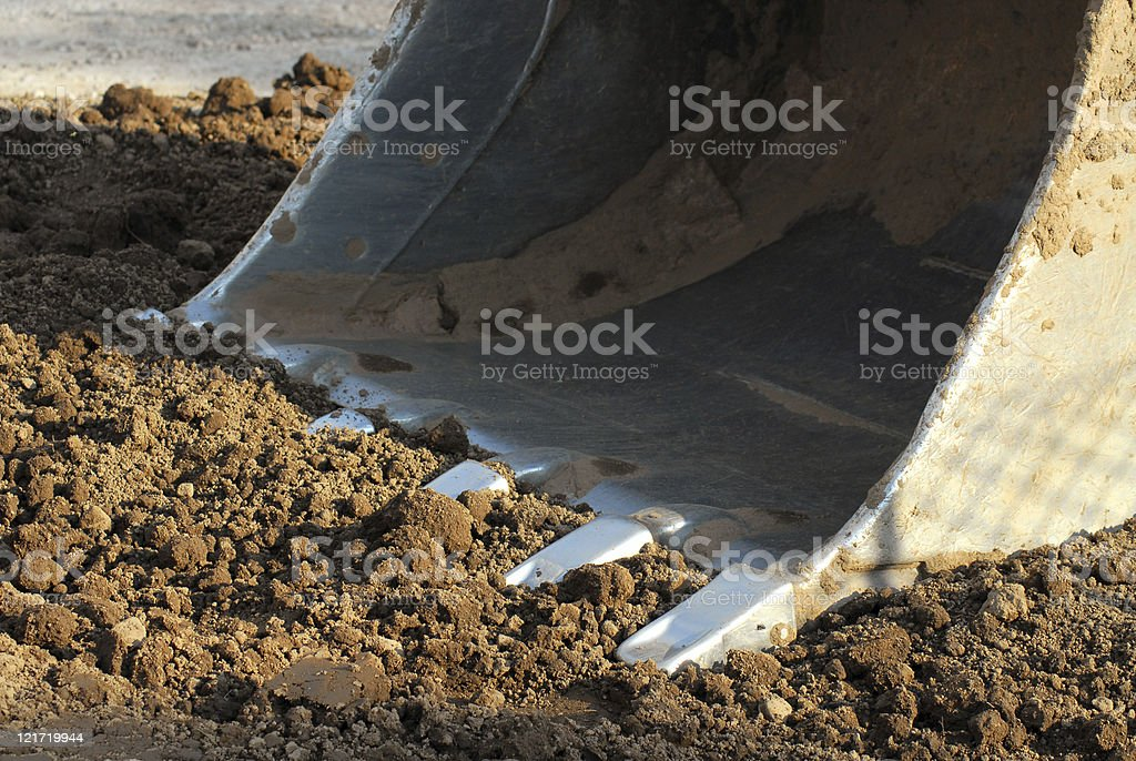 Construction vehicle about to scoop dirty royalty-free stock photo