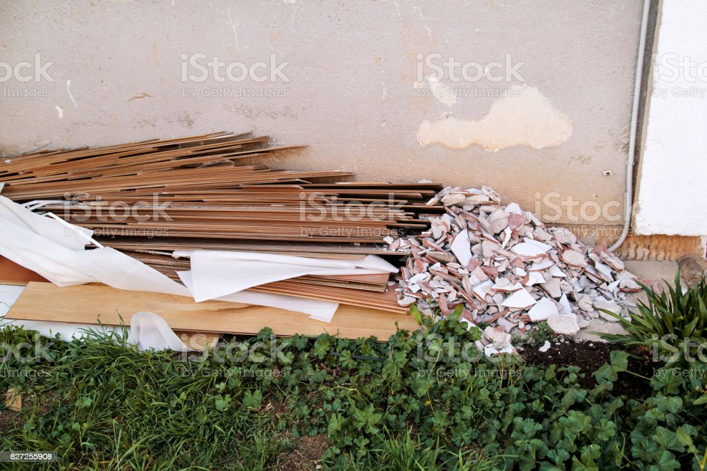 Construction waste. A pile of construction waste. Building rubble and stones. Abandoned garbage, junk, garbage piled up near the building. Street scene. Recycling industry. Ecology. Not Ecology. stock photo