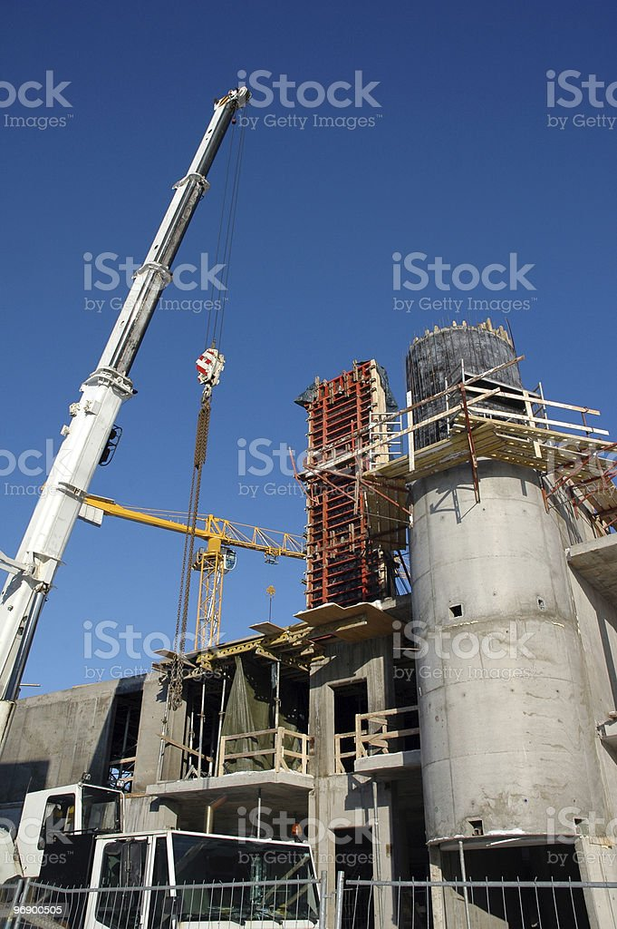 Construction work site with crane royalty-free stock photo
