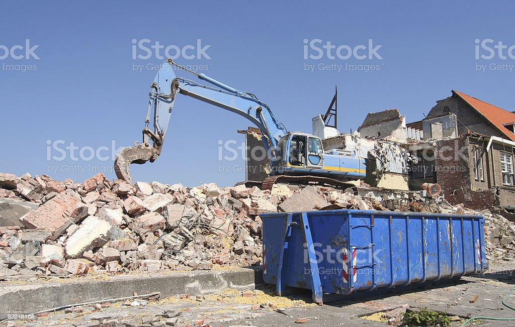Construction work using an excavator to lift heavy rocks stock photo