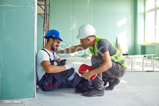 istock Construction worker accident with a construction worker. 1204179447