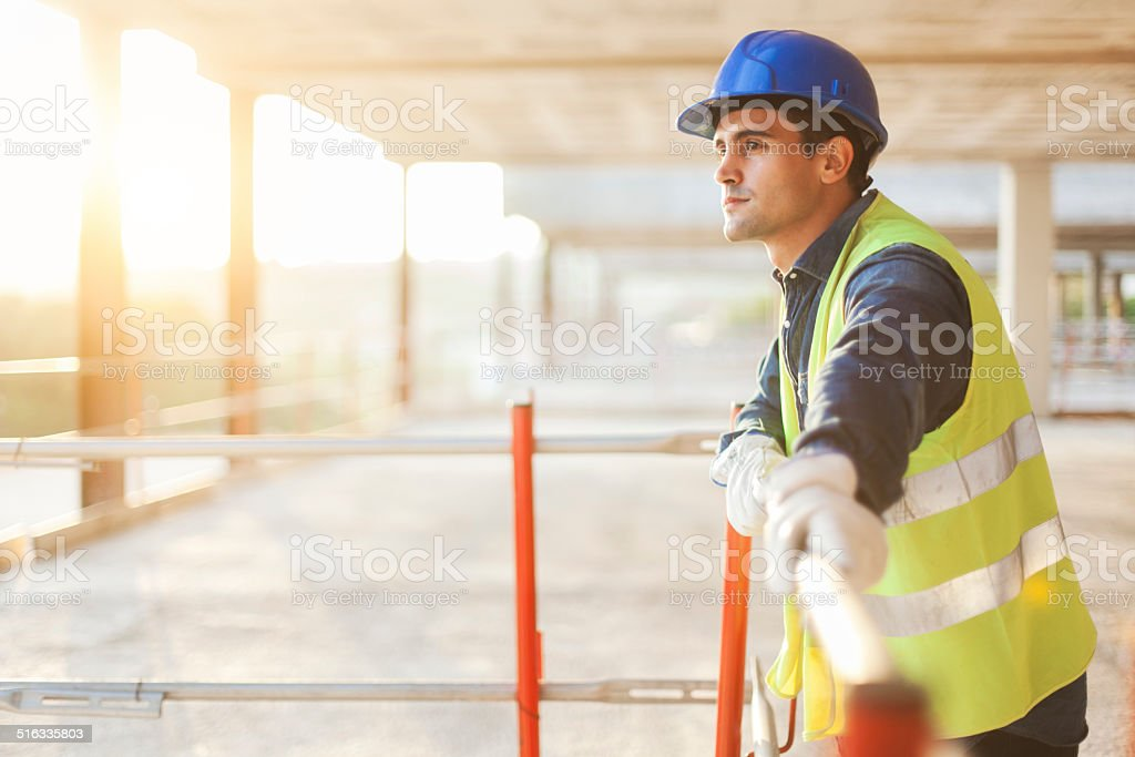 Construction worker after hard day's work. stock photo